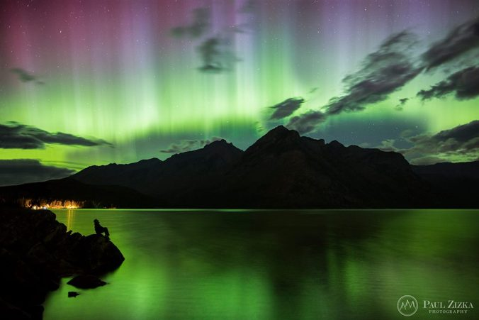 Cosmic Curtains - Aurora Borealis at Lake Minnewanka by Paul Zizka Photography